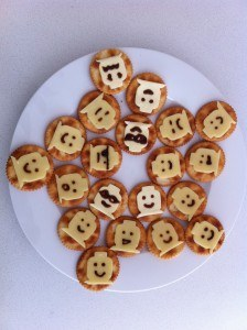 lego party food lego man cheese heads on crackers with vegemite