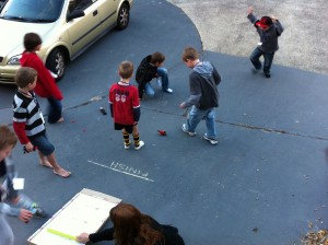 lego kids party racing cars on the driveway