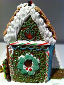 piped royal icing on gingerbread house