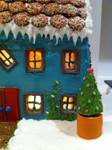 gingerbread house decoration using royal icing and fondant