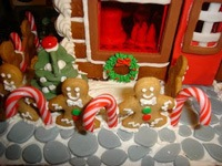 ginger bread bakery with elves inside windows