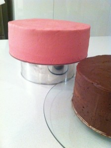 tiered first birthday cake covered in ganache