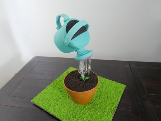watering can cake gravity defying cake