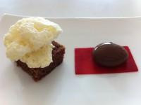 chcolate spherical served with raspberry agar gel, vanilla air and chocolate brownie